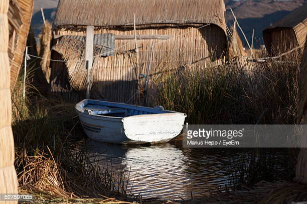 Boat In A Pond Outside A Hut