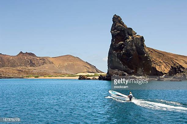 Boat in front of Pinnacle Rock Galapagos