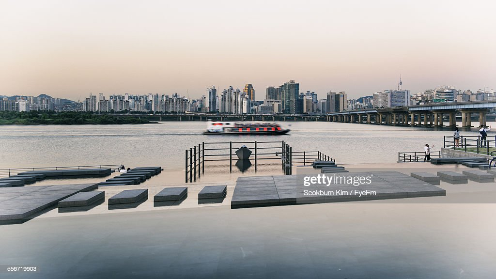 Boat In Han River By Cityscape Against Clear Sky