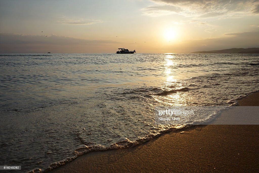 boat in sea at sunset, the black : Stock Photo