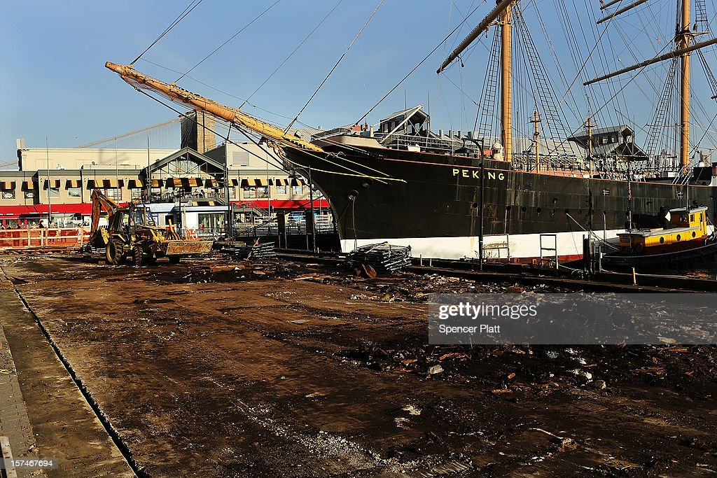 A boat is docked on a flood damaged pier affected by Superstorm Sandy at South Street Seaport on December 3, 2012 in New York City. South Street Seaport, an area popular with tourists which was about to go through a major redevelopment, suffered severe damage from Hurricane Sandy. Most of the buildings and businesses, including the South Street Seaport Museum, suffered severe flooding and remained closed. According to a new Siena Research Institute poll, most New Yorkers overwhelmingly agree that climate change was behind Hurricane Sandy.