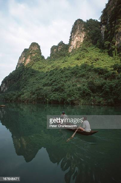 A boat is rowed down a river in the Phong Nha Nature Reserve The Vietnamese Government is proposing that this Nature Reserve become a World Heritage...