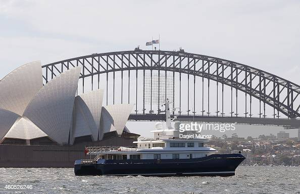 A boat is seen in front of the Sydney Harbour Bridge where the Australian and New South Wales flags are at half mast as a mark of respect for the...