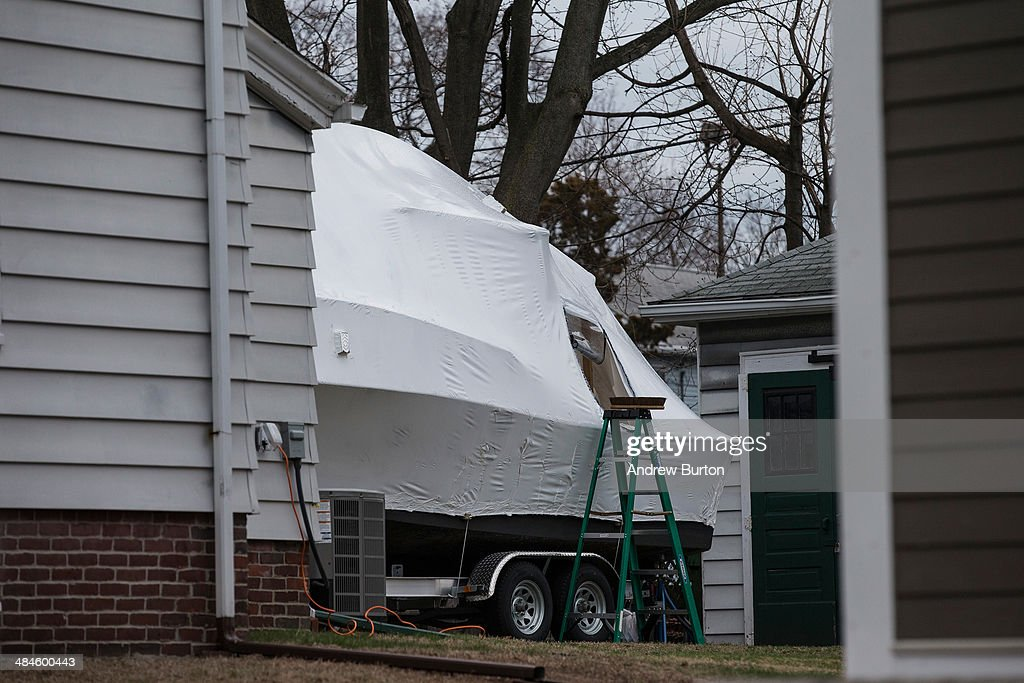 A boat is seen in the back driveway of 67 Franklin Street, where one year ago, the surviving Boston bomber Dzhokhar Tsarnaev was found hiding in a boat in, on April 13, 2014 in Watertown, Massachusetts. Last year, two pressure cooker bombs killed three and injured an estimated 264 others during the Boston marathon last year on April 15, 2013, creating a massive statewide manhunt for the bombers, which ended four days later on April 19, 2013 in Watertown, MA.