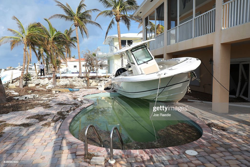 A boat is seen next to a home after Hurricane Irma passed through the area on September 13, 2017 in Duck Key, Florida. The Florida Key's took the brunt of the hurricane as it passed over the island chain as a category 4 storm.
