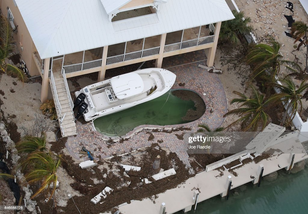 A boat is seen next to a home after Hurricane Irma passed through the area on September 13, 2017 in Duck Key, Florida. The Florida Keys took the brunt of the hurricane as it passed over the island chain as a category 4 storm.
