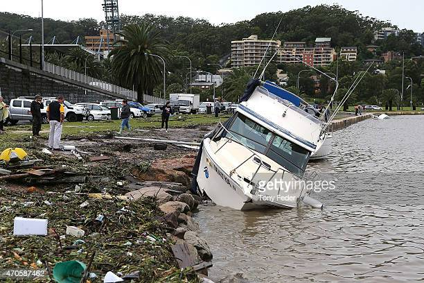 A boat is washed up on the Gosford Waterfront on the Central Coast on April 22 2015 in Sydney Australia Three people have died and more than 200000...