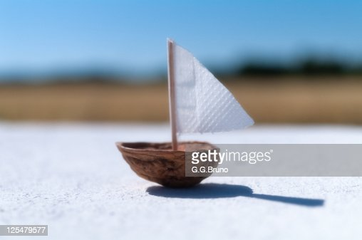 Boat made from half nutshell and paper