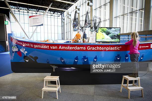 A boat made from recycled plastic garbage taken from the canals of Amsterdam is exhibited at the HISWA 2014 boat show in the RAI convention center in...