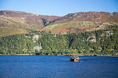 A popular way of getting from place to place in Keswick is by boat and this boat travels on a very fine day