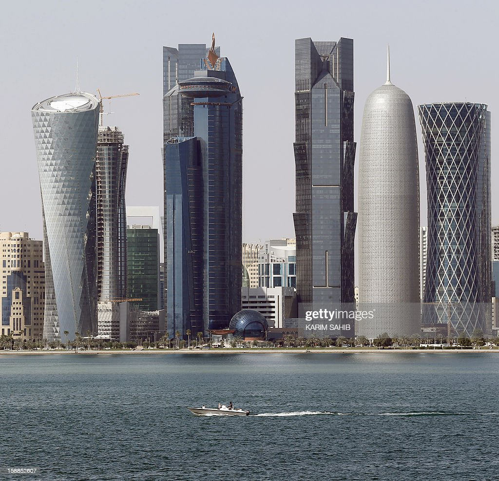 A boat makes its way with the Qatari capital Doha skyline in the background on January 1, 2013.