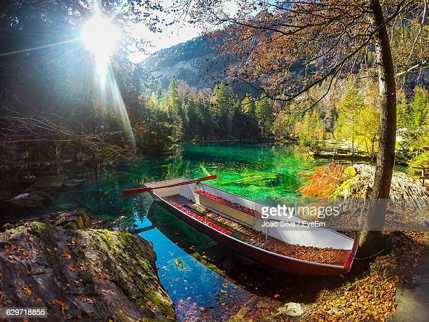Boat Moored At Blausee Lake During Autumn