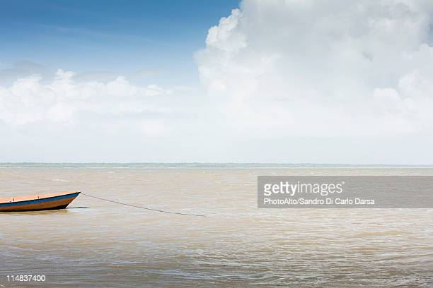 Boat moored in shallow water
