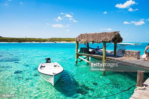 Boat moored near a pier, Exuma, Bahamas