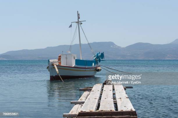 Boat Moored On Sea Against Clear Sky