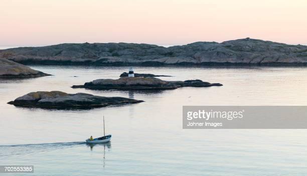 Boat near rocky coast