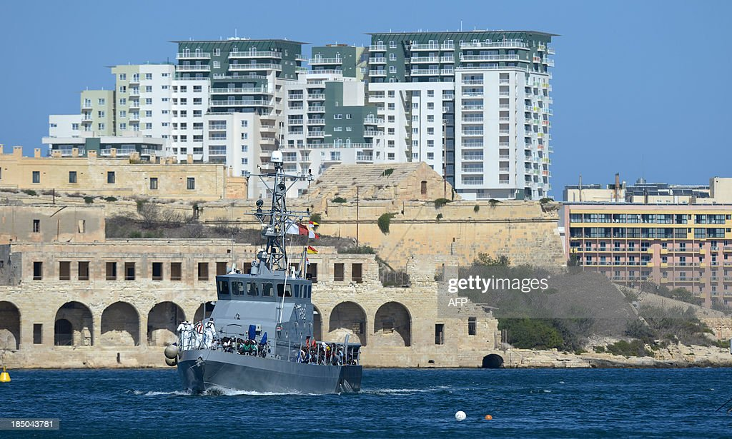 A boat of the Armed Forces of Malta makes it's way into Hay Wharf with migrants on board on October 17, 2013 in Valetta, Malta. A US warship has rescued 128 migrants from an inflatable raft that was threatening to capsize in rough seas in the Mediterranean after a request from Malta, officials said today. The USS San Antonio, which is equipped with an amphibious transport dock that can help in rescue operations, was scrambled yesterday after a Maltese military aircraft spotted the dinghy. AFP PHOTO / MATTHEW MIRABELLI - MALTA OUT