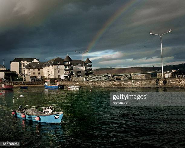 Boat on a river with rainbow