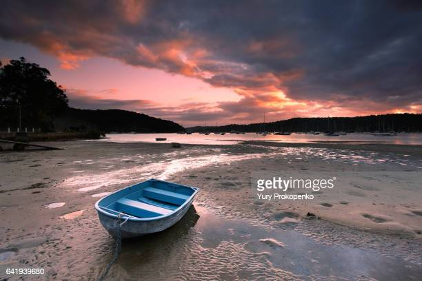 Boat on beach at sunrise