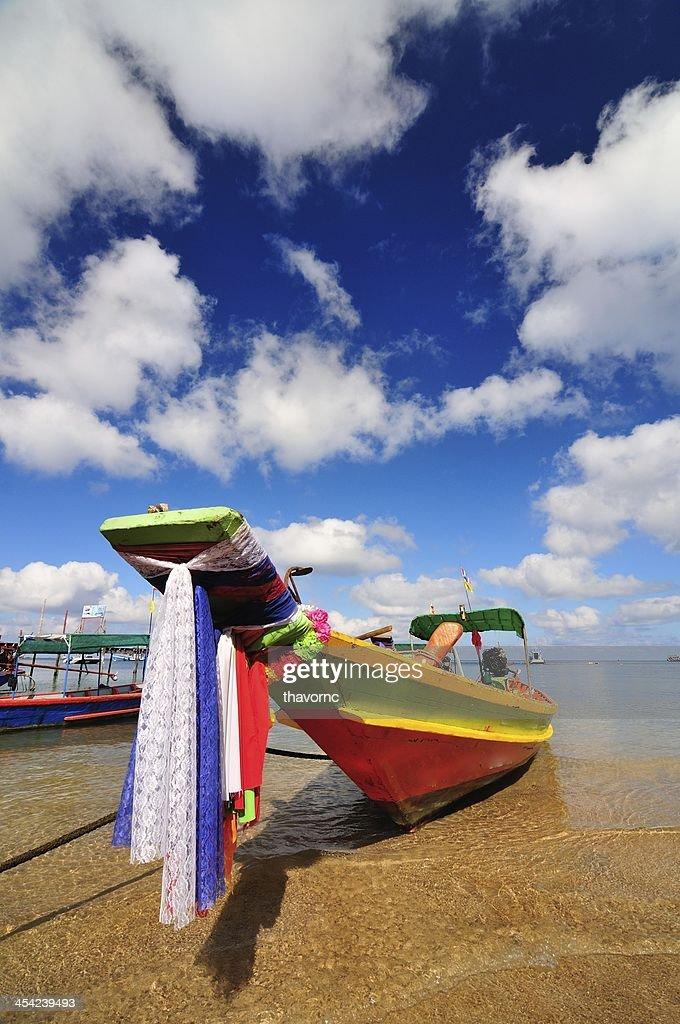 Boat on beautiful beach : Stock Photo