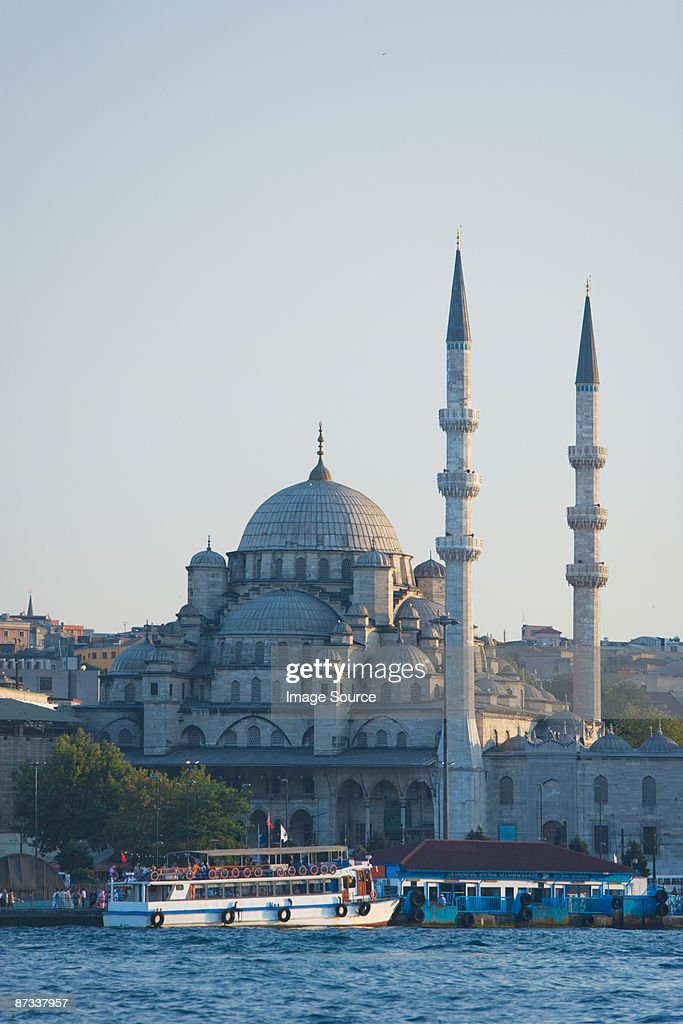 Boat on golden horn and yeni mosque : Stock Photo