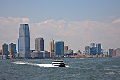 Boat on Hudson River and Jersey City skyline, from Downtown Manhattan, New York