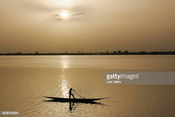 boat on Niger river at sunset