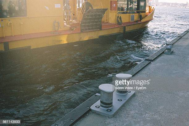 Boat On River With Mooring Bollards At Dock
