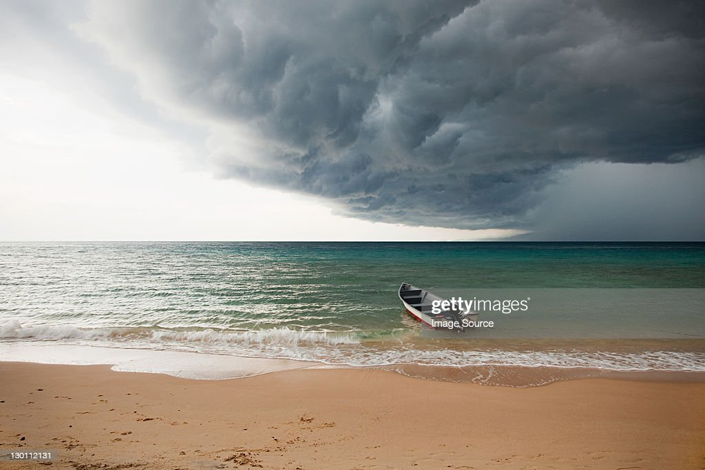 Boat on sea under stormy sky, Perhentian Kecil, Malaysia : Stock Photo