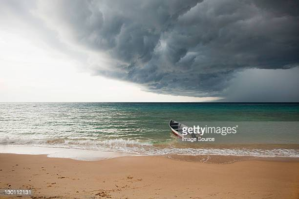 Boat on sea under stormy sky, Perhentian Kecil, Malaysia