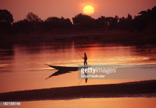 Boat on the Bani river in Mali during sunrise