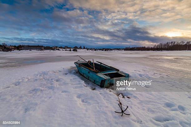 Boat on the ice at sunset