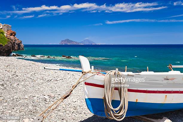 A boat on the shore of the Mediterranean