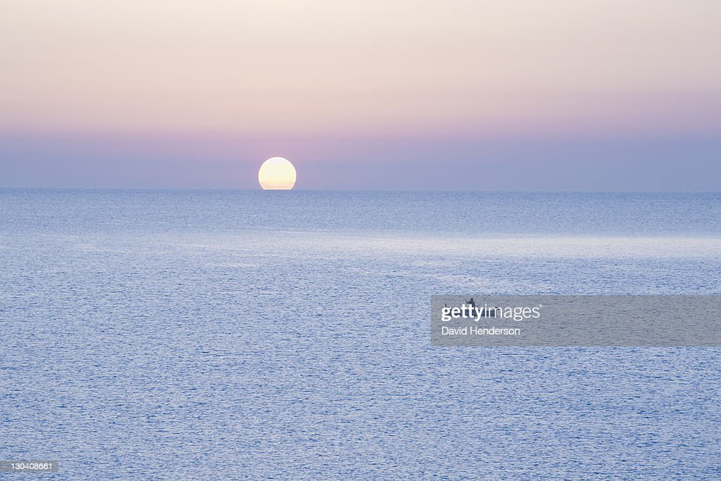 Boat on water at sunset : Stock Photo