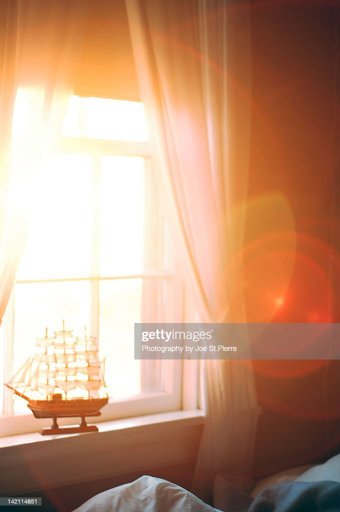 Boat on window sill : Stock Photo