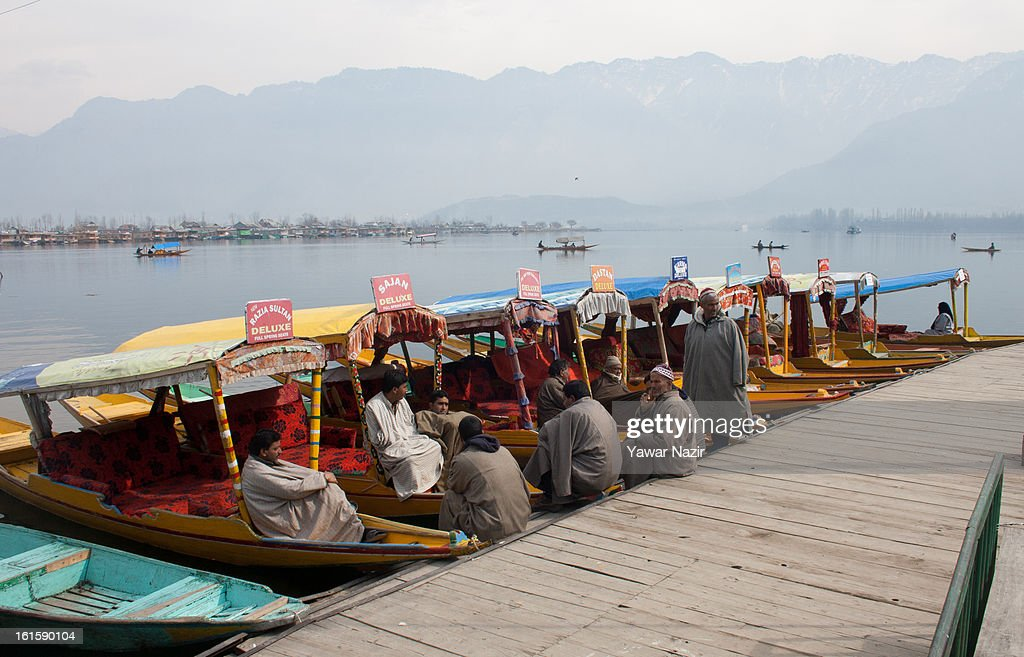Boat owners rest on the deck of their boats during a curfew, imposed after the execution of alleged Indian parliament attacker Mohammad Afzal Guru on February 12, 2013 in Srinagar, the summer capital of Indian Administered Kashmir, India. Afzal Guru, from Sopore town in the north of Kashmir, was hung on February 09 for his role in the 2001 Indian parliament attack which left 14 dead. The hanging has further strained relations between India - who blamed the attack on 'Pakistan backed' militant group Jaish-e-Mohammed - and neighbouring Pakistan and has seen an military increase from both along the border.