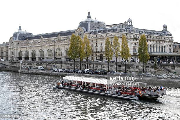 A boat passes by the Orsay museum on October 25 2011 in Paris Paris' newlyrevamped Orsay Museum remained closed to the public for a sixth day today...