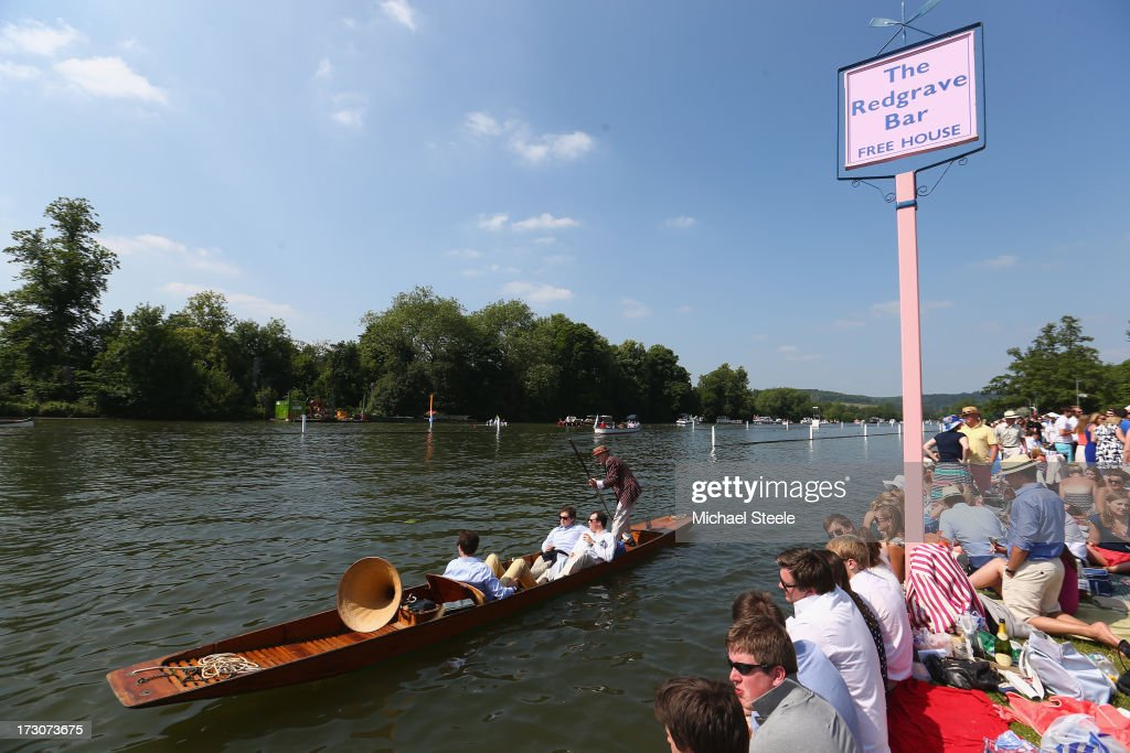 A boat passes by the Redgrave Bar alongside the racing course during day four of the Henley Royal regatta on July 6, 2013 in Henley-on-Thames, England.