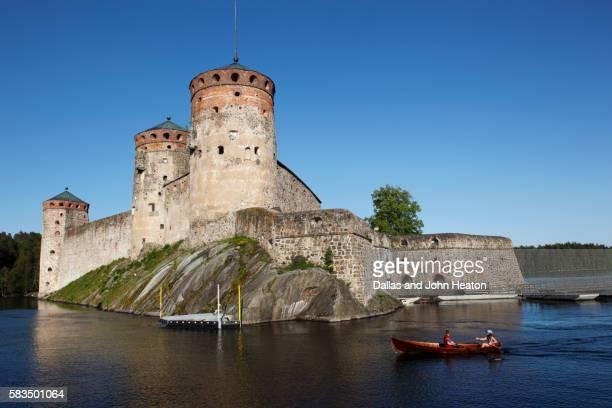 Boat passing Olavinlinna Castle on Lake Saimaa