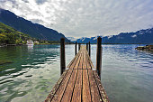 Boat wooden pier on Lake Leman. Montreux, Switzerland on  sunny day