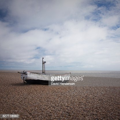 Boat pulled up on beach : Stock Photo