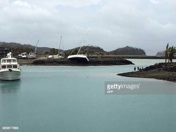 A boat ran aground on Hamilton Island after strong Cyclone Debbie hit the Whitsundays Islands in Queensland on March 29 2017 Towns were cut off and...