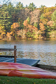rental canoes and kayaks lined up along Mirror Lake in Wisconsin in fall