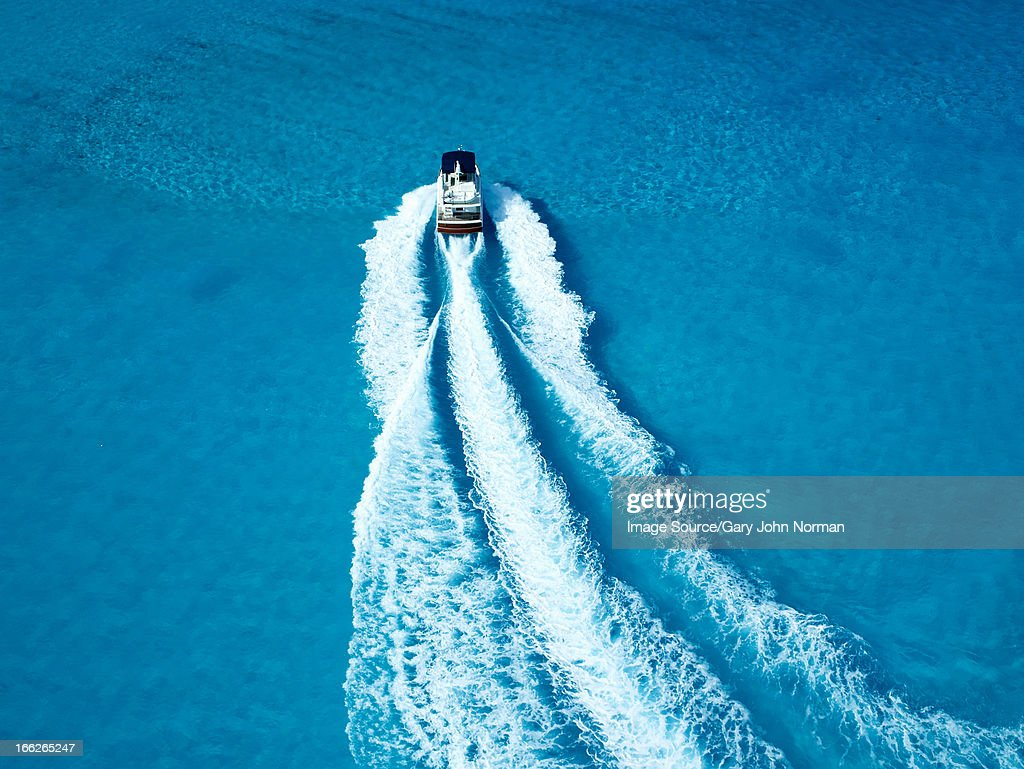 Boat sailing in tropical water