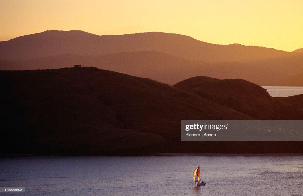 Boat sailing near island. : Stock Photo