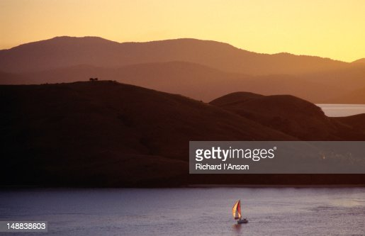 Boat sailing near island. : Stock Photo