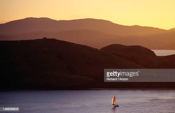 Boat sailing near island.
