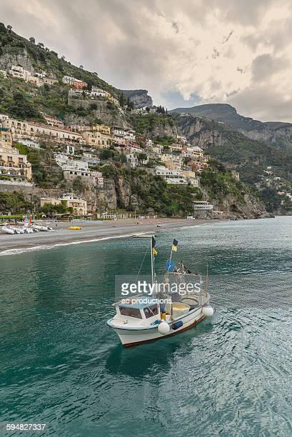 Boat sailing near Positano cityscape, Amalfi Peninsula, Italy