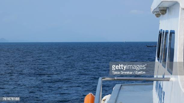 Boat Sailing On Sea Against Clear Sky
