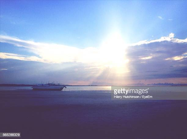 Boat Sailing On Sea Against Sky In Morning